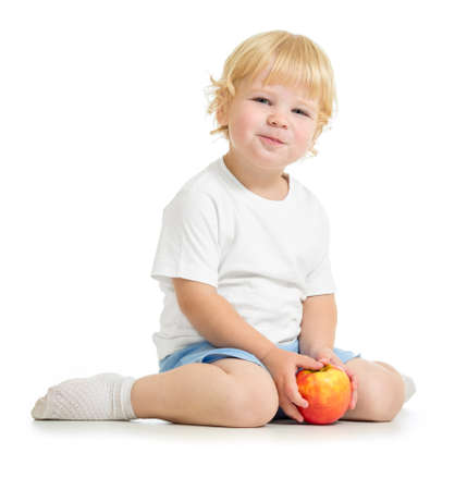 Satisfied kid eating apple Stock Photo - 22217266