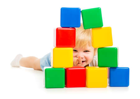baby boy hidden behind building blocks Stock Photo - 22235805