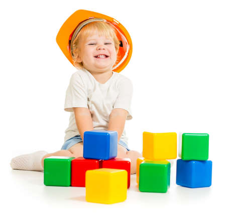 baby boy in hard hat with colorful building blocks Stock Photo - 22235804