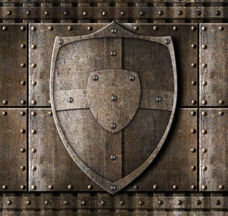 metal shield over armour background with rivets photo