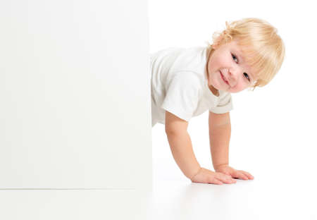 Funny kid on all fours behind banner Stock Photo - 22339108