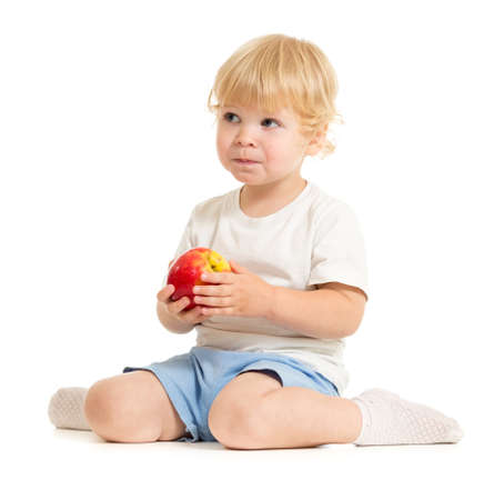 serious kid eating healthy food isolated Stock Photo - 22339110