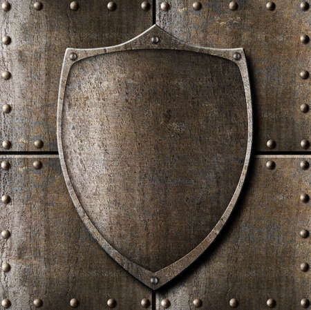 old metal shield over armour background with rivets Stock Photo - 22346158
