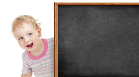 kid behind blank blackboard Stock Photo - 22339111