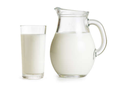 jugs: Milk jug and glass on white background Stock Photo