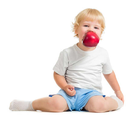 kid keeping apple in mouth Stock Photo - 22400766