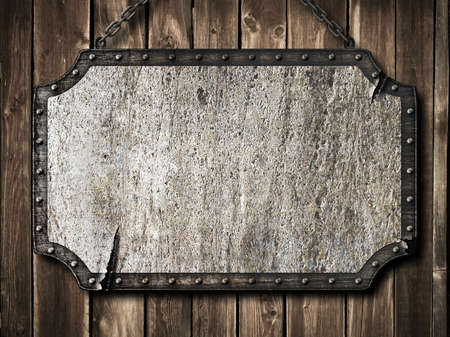 medieval signboard on wooden wall photo