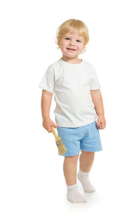 boy with paint brush front view standing full length isolated on white background photo