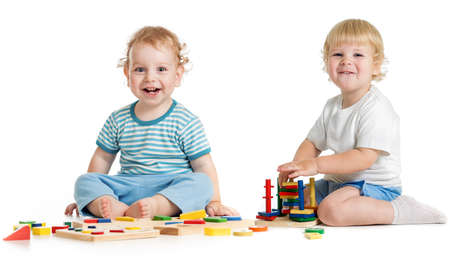 logical: Two happy kids playing logical educational toys Stock Photo
