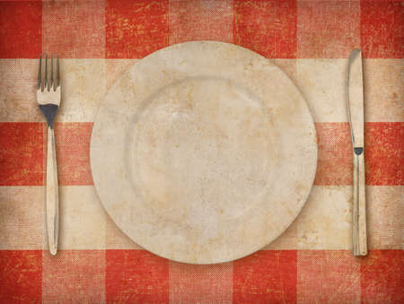 Plate, fork and knife over grunge tablecloth background Stock Photo - 22861114