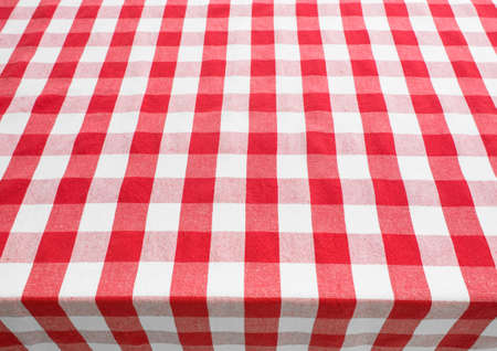 kitchen table top: empty table top view covered by red gingham tablecloth