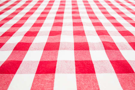 empty table top view covered by red gingham tablecloth photo