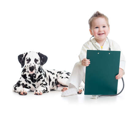 kid playing doctor with dog isolated on white photo