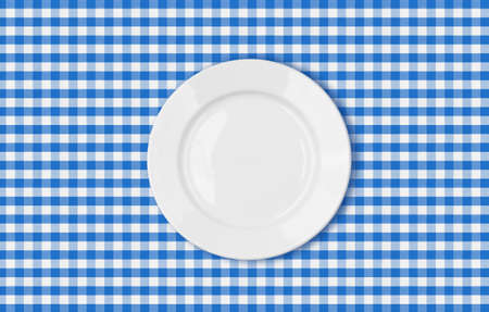 table with blue picnic cloth and plate top view photo