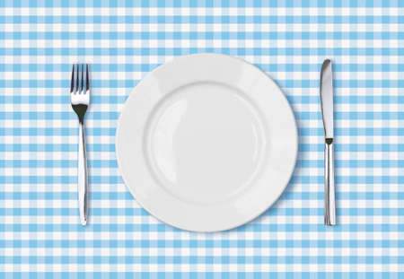 empty dinner plate top view on blue picnic table cloth photo