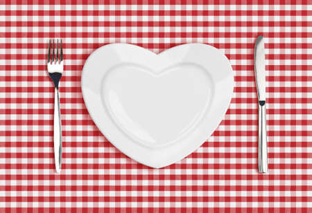 Knife, heart plate and fork on checked tablecloth Stock Photo - 22861143