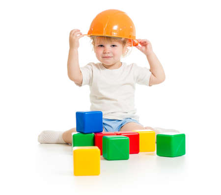 baby boy in hard hat with building blocks photo