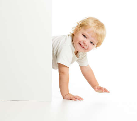 kidding: Funny kid on all fours behind wall