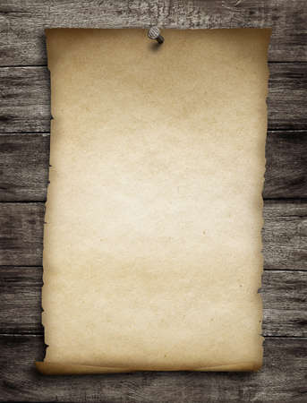 old wanted paper or parchment pinned by nail to grunge wooden background Stock Photo - 23212407