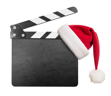 hollywood movie: Clapper board with Santas hat on it isolated on white