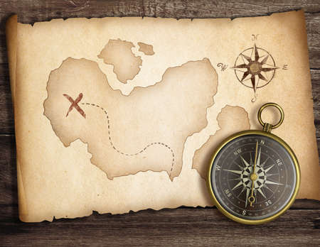 Adventure concept  Old compass on table with treasure map  photo