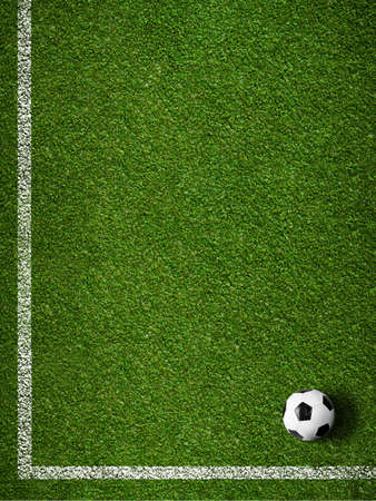 Soccer grass field with marking and ball top view photo