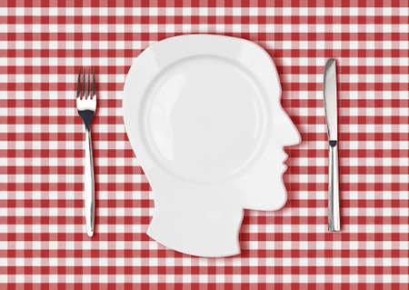 head dish or plate on red picnic tablecloth with knife and fork photo