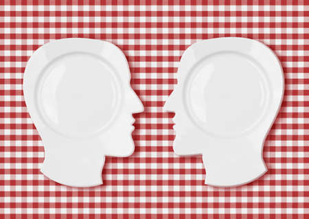 picnic tablecloth: Two head plates face to face on red picnic tablecloth