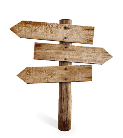 wooden arrow sign post or road signpost isolated photo