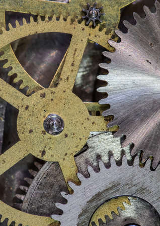 clock mechanism gears and cogs close up photo