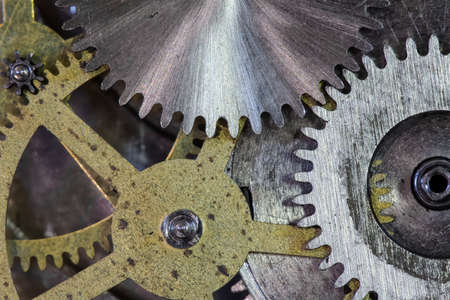clock gears and cogs macro background photo