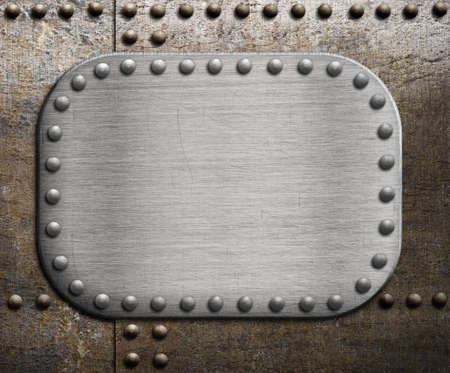 Rough metallic plate over rusty metal background. photo