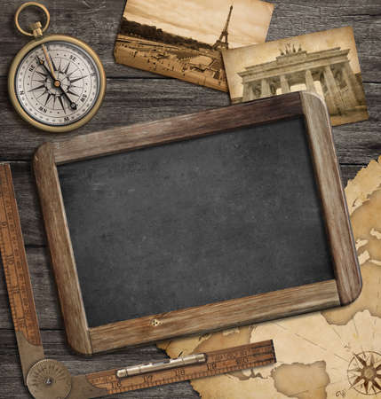 adventure nautical with vintage treasure map, blackboard and compass photo