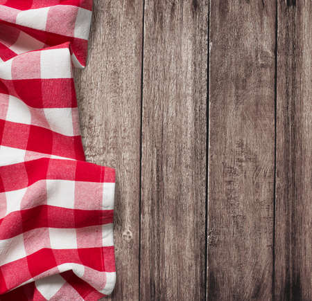 picnic tablecloth: old wooden table with red picnic tablecloth and copyspace