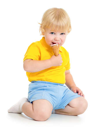 Kid boy eating ice cream photo