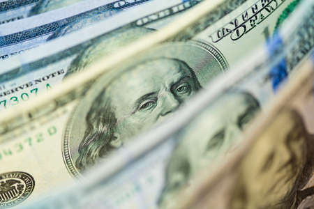 dollar bills: One old type hundred dollar banknote with presidents eyes focused Stock Photo