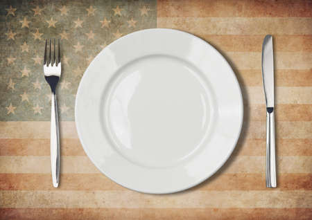 Plate, fork and knife on old USA flag photo
