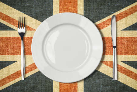 british food: Plate, knife and fork over british flag canvas