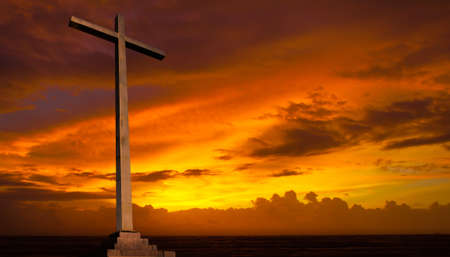 rise and shine: Christian cross on sunset sky. Religion background.