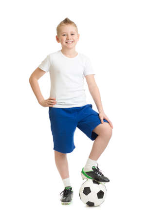 Boy standing with soccer ball isolated on white photo