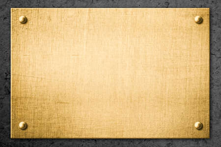 sign plate: golden metal plate or signboard on wall background