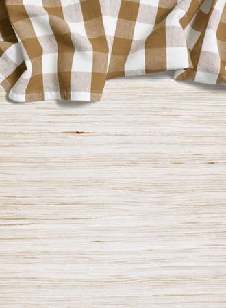 folded tablecloth over bleached wooden table Stock Photo - 25790525