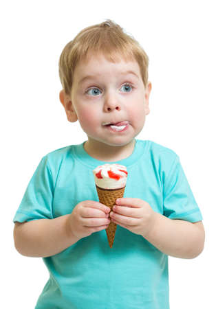 Funny boy eating icecream isolated on white photo