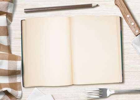 blank cooking recipe notes or book  with pencil on kitchen table photo
