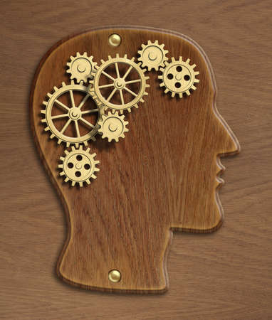 psychical: Brain wooden model made from gold metal gears and cogs