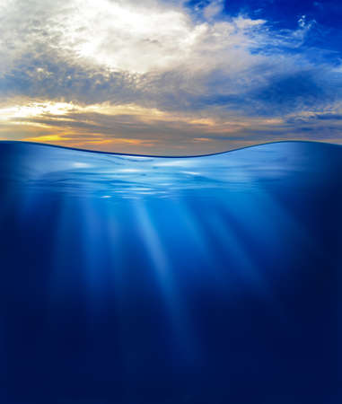 beneath the surface: sea or ocean underwater with sunset sky