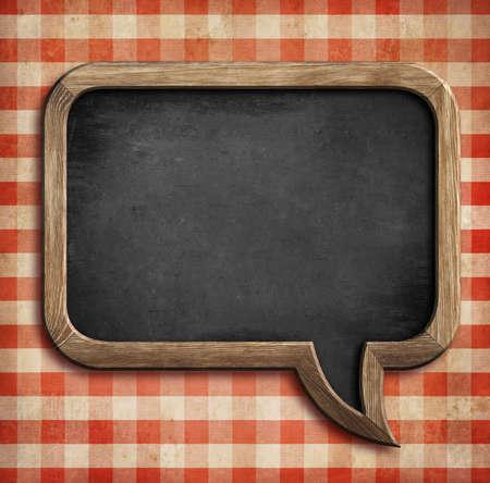 red gingham: menu chalkboard on table in shape of speech bubble