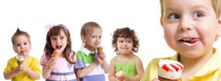happy boy in front of kids group with ice cream isolated photo