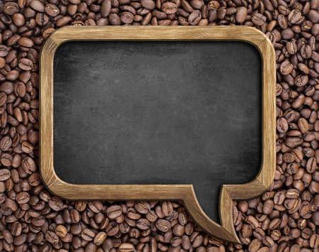 speech bubble blackboard over coffee beans background photo