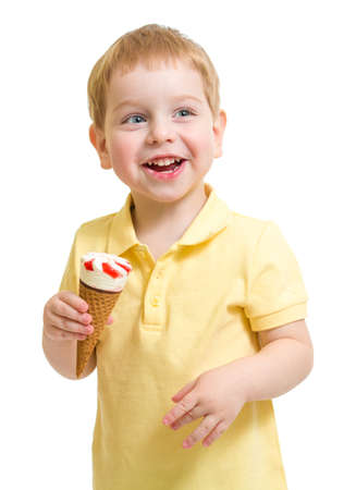 Kid boy eating ice cream isolated on white studio shot photo